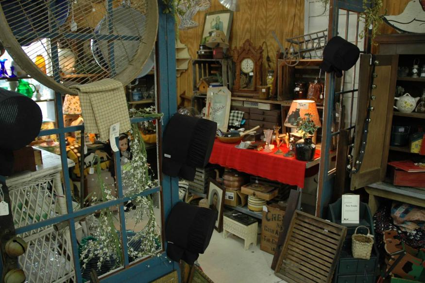 Interior of an antique store with a variety of vintage goods scattered about