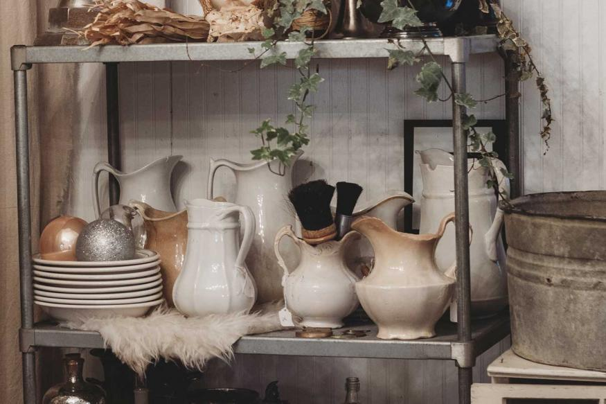 Store shelves with a variety of vases and decorative containers
